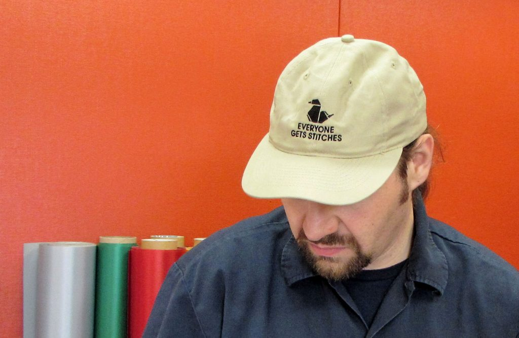 Erich Campbell in a Black Duck Dad Hat - Everyone gets stitches