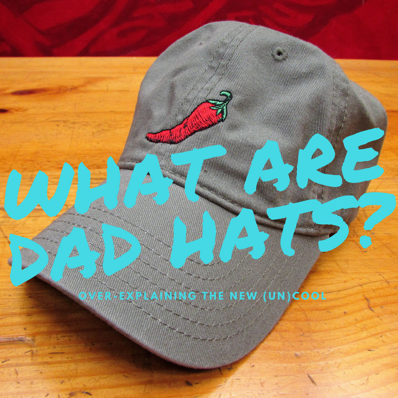 What are Dad Hats? Shows a picture of a soft-crowned hat with an embroidered Chile motif