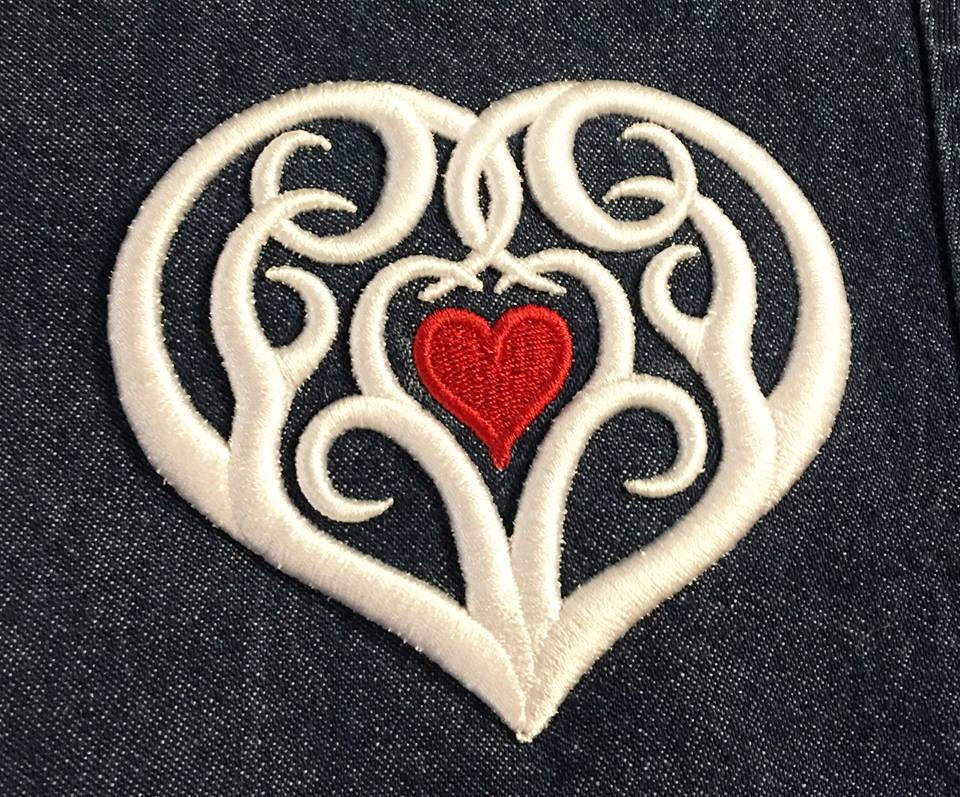 Tribal Heart 3D Foam design in white and red as stitched by Jane Swanzy